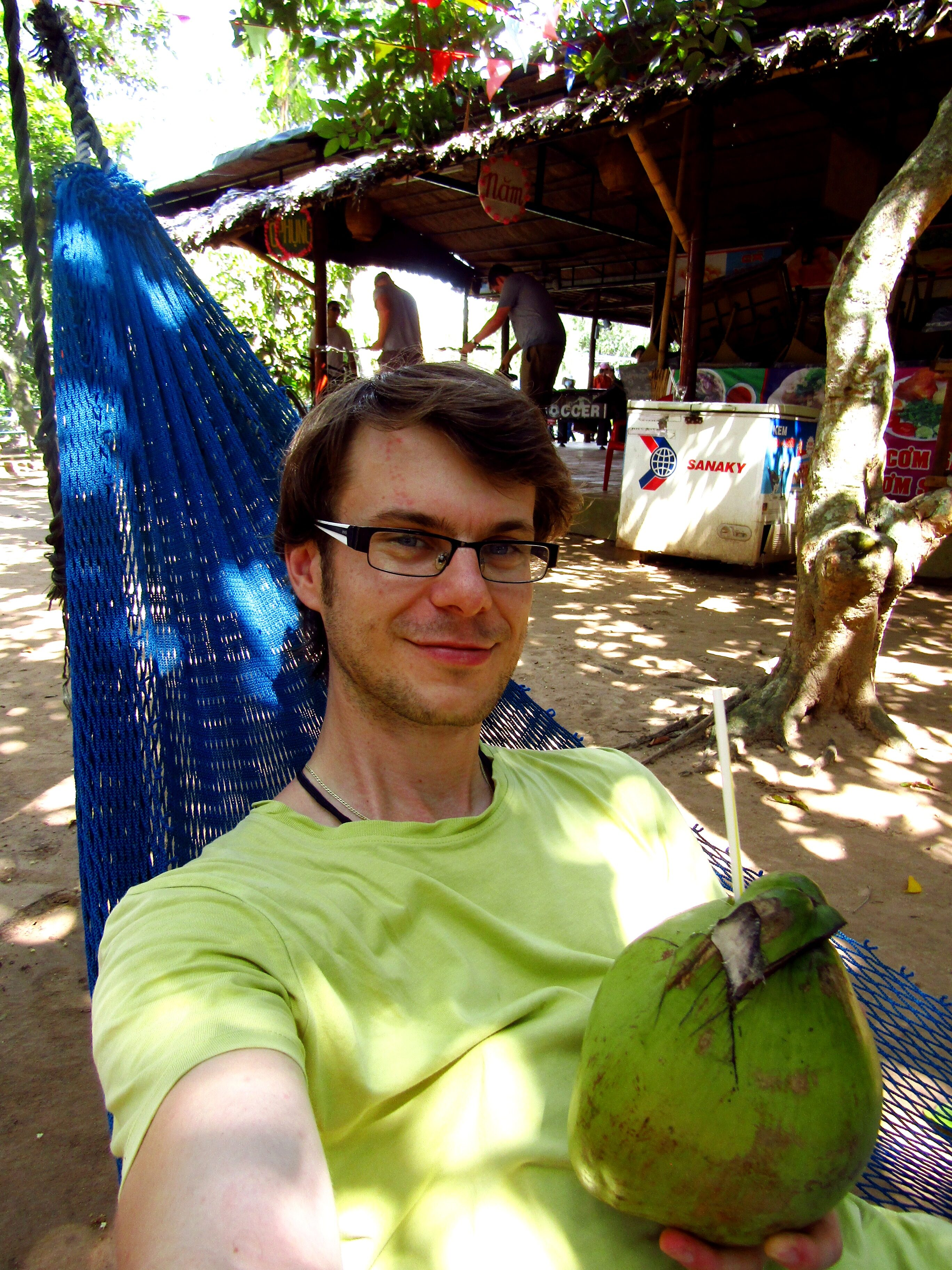 Sipping fresh coconut while chilling in a hammock