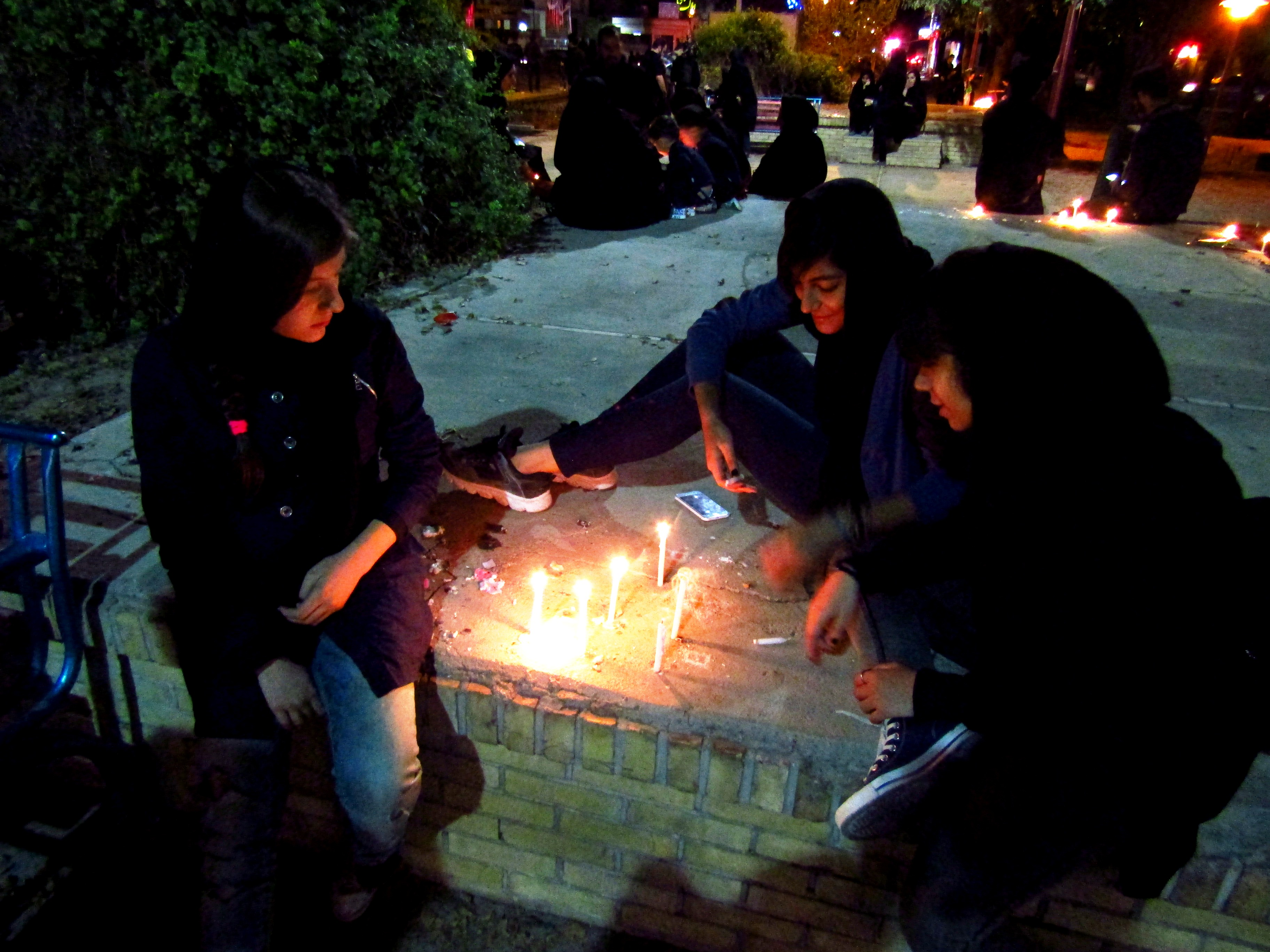 Lighting candles with Hani's family [in Yazd]